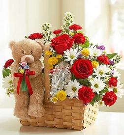Cesta de flores frescas con peluche