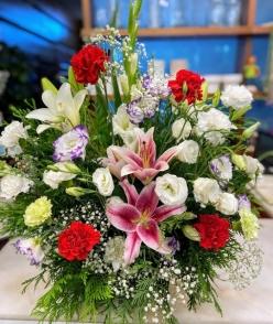 Centro de flor fresca variada