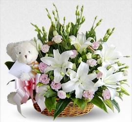 Centro  de flor fresca con peluche